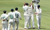 South Africa's celebrate the wicket of Sri Lanka's Kusal Mendis, on day one of the first cricket test match between South Africa and Sri Lanka at Super Sport Park Stadium in Pretoria, South Africa, Saturday, Dec. 26, 2020. (AP Photo/Catherine Kotze)