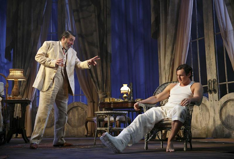 """This undated theater image released by Boneau/Bryan-Brown shows Ciaran Hinds, left, and Benjamin Walker during a performance of """"Cat on a Hot Tin Roof,"""" playing at the Richard Rodgers Theatre in New York. (AP Photo/Boneau/Bryan-Brown, Joan Marcus)"""