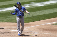 Kansas City Royals' Whit Merrifield walks to the dugout after striking out against the Oakland Athletics during the third inning of a baseball game in Oakland, Calif., Saturday, June 12, 2021. (AP Photo/Jeff Chiu)