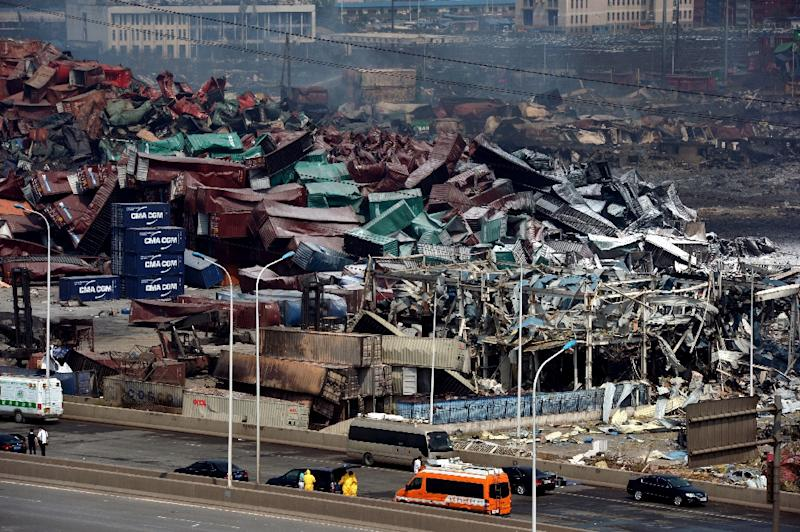 Mangled cargo containers and wreckage are seen at the site of the explosions in Tianjin on August 16, 2015 (AFP Photo/)
