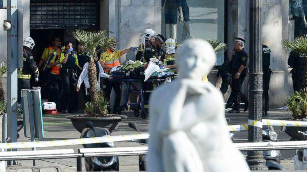 PHOTO: A person is stretched out of a mall by medical staff members in a cordoned off area after a van ploughed into the crowd, injuring several persons on the Rambla in Barcelona, Aug. 17, 2017. (Josep Lago/AFP/Getty Images)