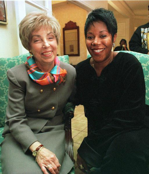 FILE - In this Jan. 16, 1998 file photo, Barbara Henry, a former teacher at William Frantz Elementry school in New Orleans, left, and her 1960 first grade student Ruby Bridges-Hall, pose for a portrait in Boston. Ruby Bridges will be one of the presenting authors at this weekend's New Orleans Children's Book Festival, an event Bridges helped launch in 2010. (AP Photo/Steven Senne, file)
