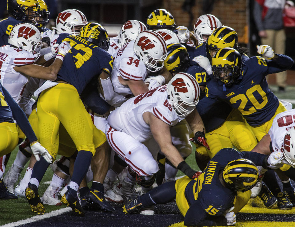 Wisconsin fullback Mason Stokke (34) scores a touchdown against Michigan during the second quarter of an NCAA college football game in Ann Arbor, Mich., Saturday, Nov. 14, 2020. (AP Photo/Tony Ding)