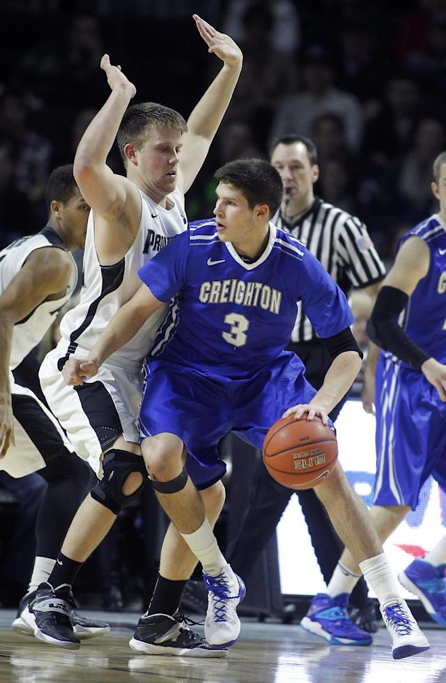 Creighton forward Doug McDermott (3) is defended by Providence guard Ted Bancroft, left, during the second half of an NCAA college basketball game on Saturday, Jan. 18, 2014, in Providence, R.I. Providence defeated Creighton 81-68. (AP Photo/Stew Milne)