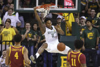 Baylor guard Mark Vital (11) dunks in front of Iowa State forward George Conditt IV (4) and guard Prentiss Nixon (11) during the first half of an NCAA college basketball game Wednesday Jan. 15, 2020, in Waco, Texas. (AP Photo/Jerry Larson)