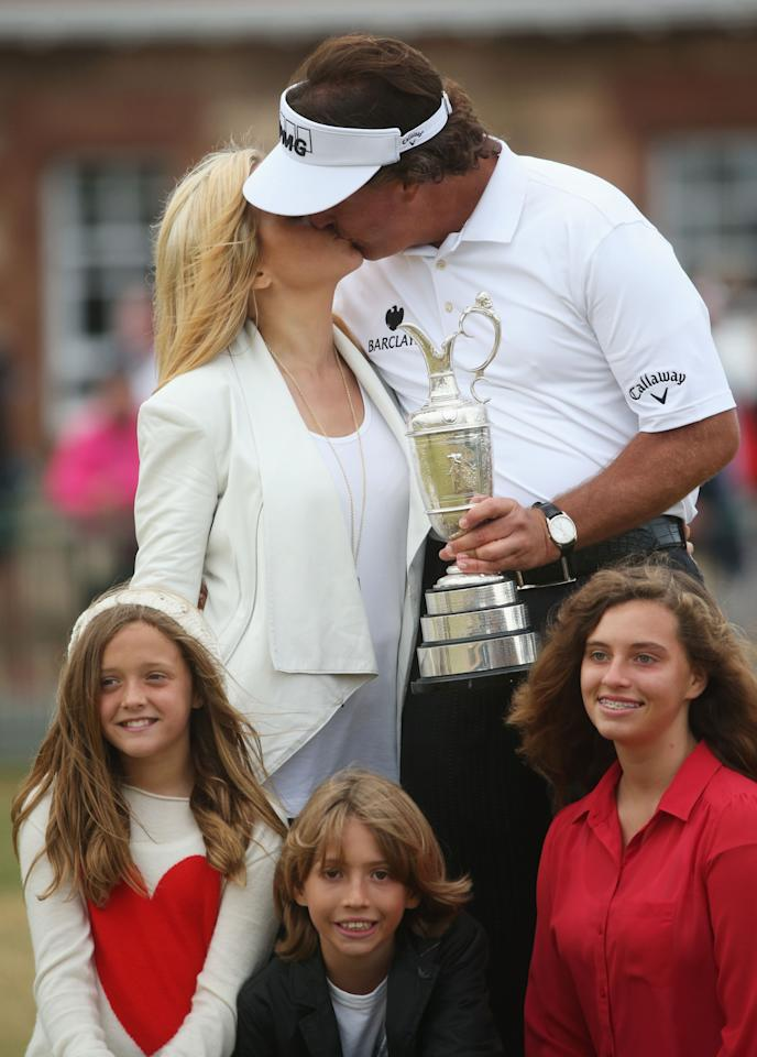 GULLANE, SCOTLAND - JULY 21: Phil Mickelson of the United States kisses wife Amy with children Evan, Amanda and Sophia after winning the 142nd Open Championship at Muirfield on July 21, 2013 in Gullane, Scotland. (Photo by Andrew Redington/Getty Images)