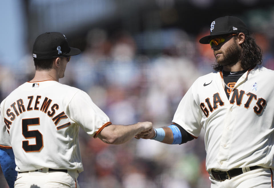 Mike Yastrzemski and Brandon Crawford of the San Francisco Giants celebrate a win. (Photo by Thearon W. Henderson/Getty Images)