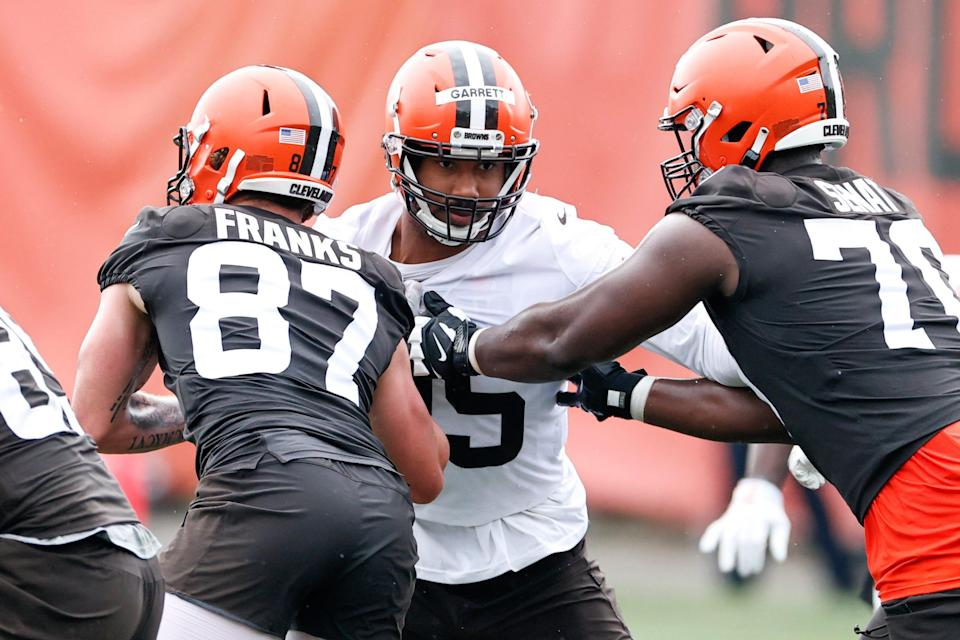 Cleveland Browns defensive end Myles Garrett, center, works against Jordan Franks (87) and Greg Senat (70) during an NFL football practice at the team's training facility Wednesday, June 2, 2021, in Berea, Ohio. (AP Photo/Ron Schwane)