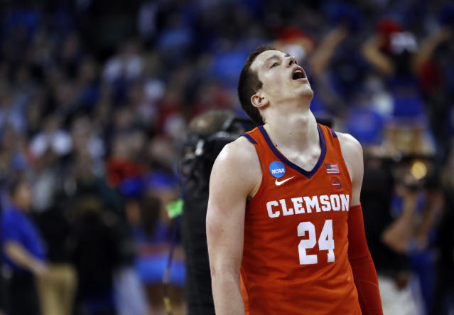 Clemson's David Skara pauses following a regional semifinal game against Kansas in the NCAA men's college basketball tournament Friday, March 23, 2018, in Omaha, Neb. Kansas won 80-76. (AP Photo/Nati Harnik)