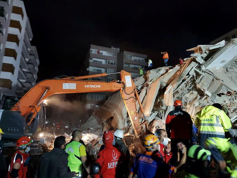 Rescque teams search for survivors at a collapsed building after a strong earthquake struck the Aegean Sea where some buildings collapsed in the coastal province of Izmir