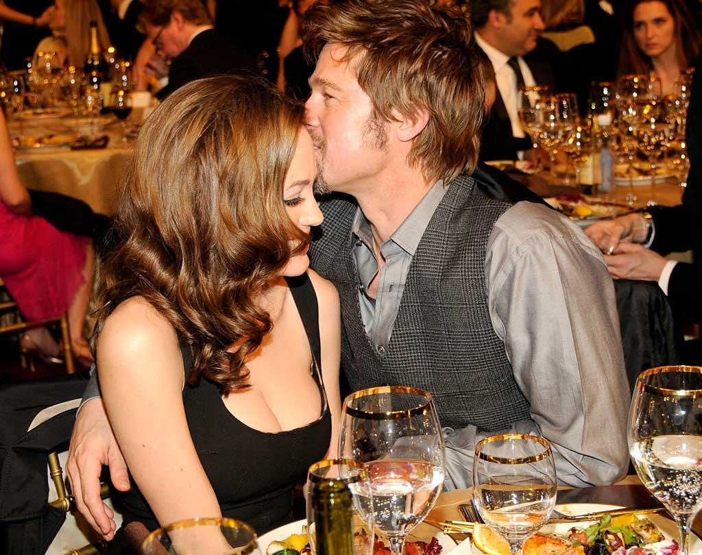 "Angelina Jolie and Brad Pitt cozy up at the event. We've never seen them looking so lovey-dovey! Kevin Mazur/<a href=""http://www.wireimage.com"" target=""new"">WireImage.com</a> - January 7, 2008"