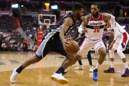 Dec 13, 2017; Washington, DC, USA; Memphis Grizzlies guard Andrew Harrison (5) drives to the basket as Washington Wizards forward Mike Scott (30) defends in the first quarter at Capital One Arena. Geoff Burke-USA TODAY Sports