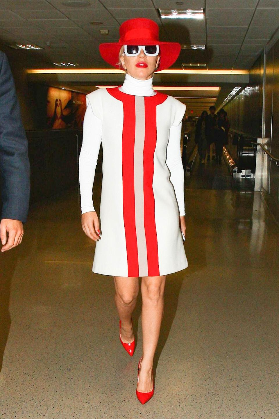 <p>No meat dress this time - the pop star at LAX in crisp (if not comfy-looking) red and white.</p>