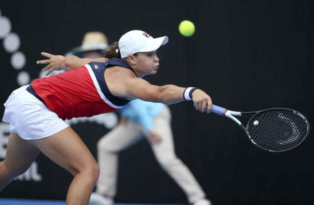 Ash Barty of Australia hits a backhand to Kiki Bertens of the Netherlands during their women's singles semifinal match at the Sydney International tennis tournament in Sydney, Friday, Jan. 11, 2019. (AP Photo/Rick Rycroft)