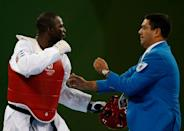 """<p>It's not uncommon for Olympic athletes to get angry at referees, but <a href=""""https://go.redirectingat.com?id=74968X1596630&url=https%3A%2F%2Fwww.espn.com%2Folympics%2Fsummer08%2Fjudo%2Fnews%2Fstory%3Fid%3D3549903&sref=https%3A%2F%2Fwww.redbookmag.com%2Flife%2Fg36983465%2Ficonic-olympic-scandals%2F"""" rel=""""nofollow noopener"""" target=""""_blank"""" data-ylk=""""slk:Cuban taekwondo athlete Ángel Matos took it a step further by kicking one square in the face"""" class=""""link rapid-noclick-resp"""">Cuban taekwondo athlete Ángel Matos took it a step further by kicking one square in the face</a>. He was upset after getting disqualified from a bronze medal match, and his violent gesture got him banned from international taekwondo events for life.</p>"""