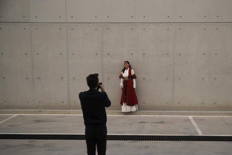 """Greek soprano Artemis Bogri poses for the photographer Andreas Simopoulos before a rehearsal of """"Despo-Greek Dances"""" Opera and dance performance in Athens, Thursday, March 4, 2021. Dozens of museum exhibitions, theater productions, discussion panels and historical re-enactments were planned in Greece for this year to commemorate the bicentennial of the 1821-1832 Greek War of Independence. But due to the coronavirus pandemic, mezzo-soprano Artemis Bogri and her fellow singers stepped onstage in an empty theater to perform the Greek National Opera's new production of """"Despo,"""" one of the events marking 200 years since the war that resulted in Greece's independence from the Ottoman Empire and rebirth as a nation. (AP Photo/Thanassis Stavrakis)"""