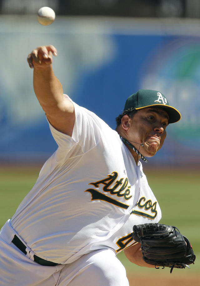 Oakland Athletics starting pitcher Bartolo Colon (40) throws against the Houston Astros during the first inning of a baseball game, Sunday, Sept. 8, 2013, in Oakland, Calif. (AP Photo/Tony Avelar)