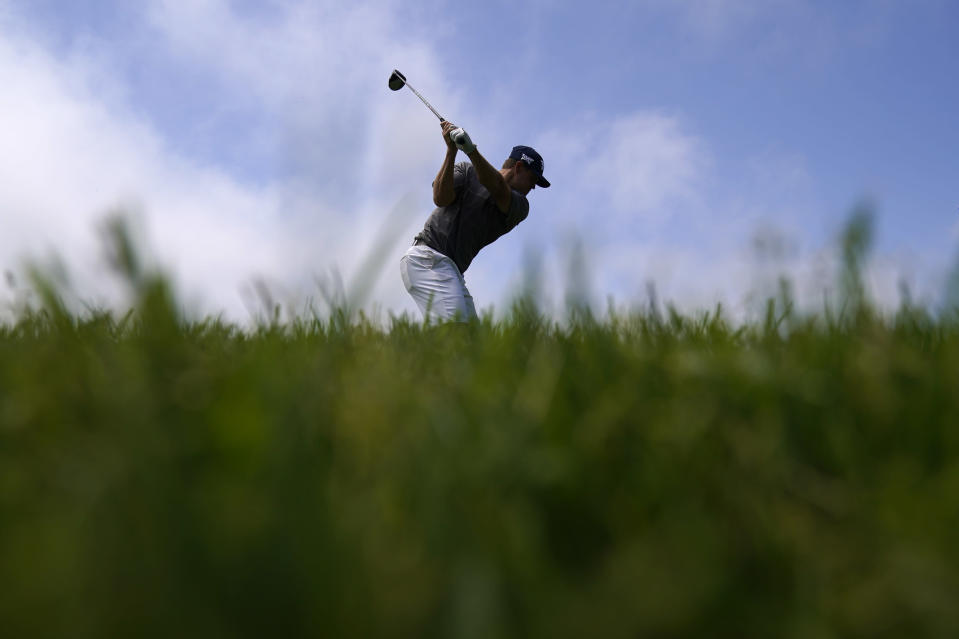 Kyle Westmoreland hits his tee shot on the 14th hole during a practice round of the U.S. Open Golf Championship, Monday, June 14, 2021, at Torrey Pines Golf Course in San Diego. (AP Photo/Gregory Bull)