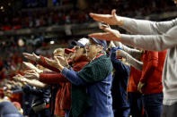 Fans gesture the baby shark as Washington Nationals' Gerardo Parra bats during the sixth inning of Game 3 of the baseball World Series against the Houston Astros Friday, Oct. 25, 2019, in Washington. (AP Photo/Patrick Semansky)