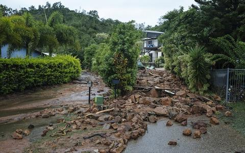 Rocks are seen blocking Muller Street in Wulguru, Townsville, as flooding continues in northern Queensland - Credit: Reuters