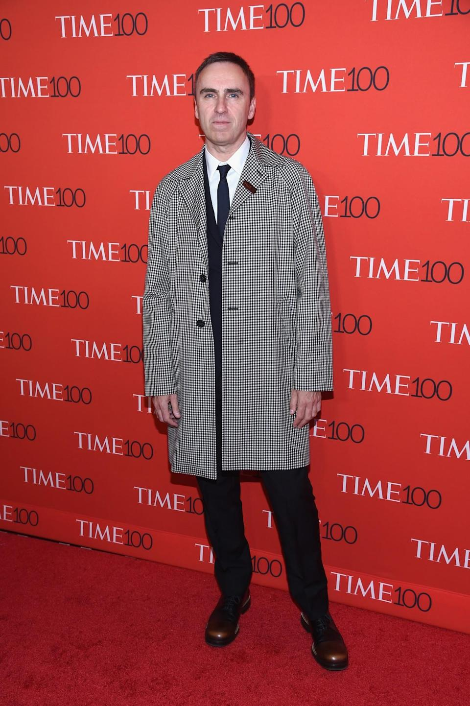 <p>The designer stood out in a houndstooth coat. (Photo: Getty Images) </p>