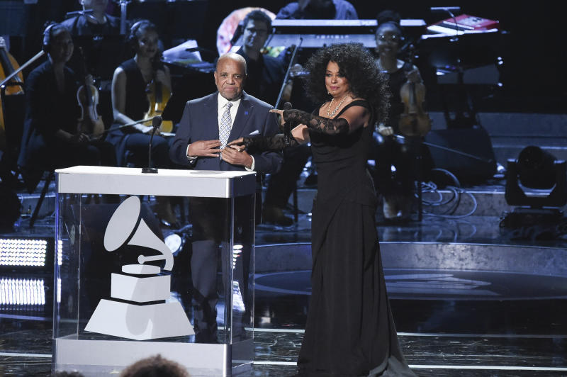 "FILE - In this Tuesday, Feb.12, 2019 file photo, Berry Gordy, left, and Diana Ross speak onstage during Motown 60: A GRAMMY Celebration at the Microsoft Theater in Los Angeles. Gordy says his historic label brought people from all walks of life through a ""legacy of love"" at the ""Motown 60: A Grammy Celebration"" during a taped tribute that will air April 21 on CBS. (Photo by Richard Shotwell/Invision/AP, File)"