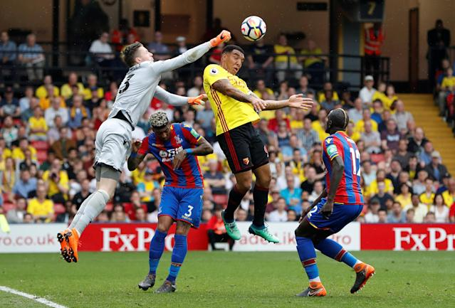 """Soccer Football - Premier League - Watford v Crystal Palace - Vicarage Road, Watford, Britain - April 21, 2018 Crystal Palace's Wayne Hennessey punches clear of Watford's Troy Deeney Action Images via Reuters/Paul Childs EDITORIAL USE ONLY. No use with unauthorized audio, video, data, fixture lists, club/league logos or """"live"""" services. Online in-match use limited to 75 images, no video emulation. No use in betting, games or single club/league/player publications. Please contact your account representative for further details."""
