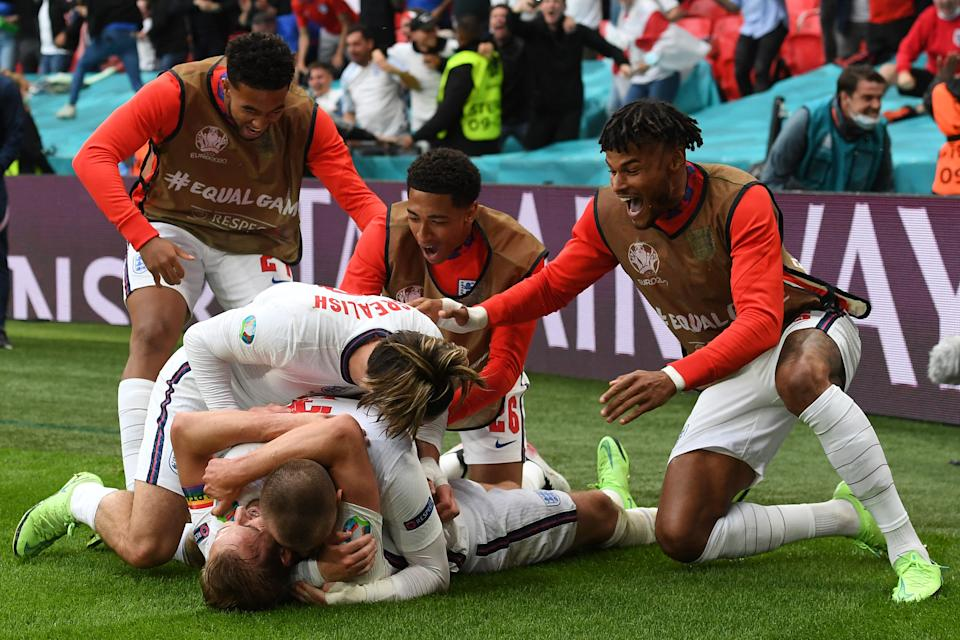 England's players celebrate their second goal during the UEFA EURO 2020 round of 16 football match between England and Germany at Wembley Stadium in London on June 29, 2021. (Photo by Andy Rain / POOL / AFP) (Photo by ANDY RAIN/POOL/AFP via Getty Images)