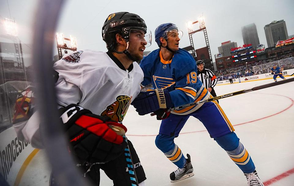 <p>ST LOUIS, MO – JANUARY 02: Vinnie Hinostroza #48 of the Chicago Blackhawks and Jay Bouwmeester #19 of the St. Louis Blues look up the ice in the first period during the 2017 Bridgestone NHL Winter Classic at Busch Stadium on January 2, 2017 in St Louis, Missouri. (Photo by Chase Agnello-Dean/NHLI via Getty Images) </p>