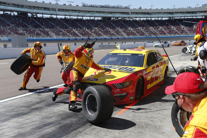 Joey Logano makes a pit stop for fuel and tires on lap 79 during a NASCAR Cup Series auto race at Phoenix Raceway, Sunday, March 14, 2021, in Avondale, Ariz. (AP Photo/Ralph Freso)