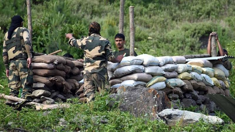Indian soldiers erect a military bunker along the Srinagar-Leh National highway on 16 June