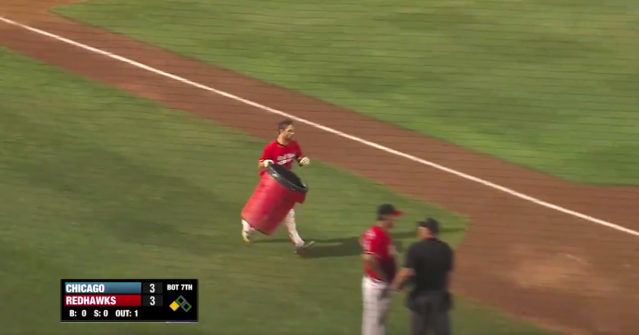 Brennan Metzger decided to bring a garbage can onto the field after getting ejected from a game. (Screegrab via @FMRedHawks on Twitter)