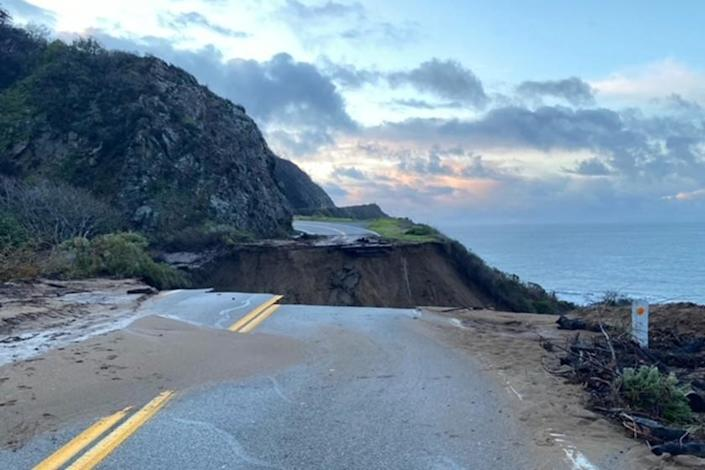 In this photo provided by Caltrans, a section of Highway 1 is collapsed following a heavy rainstorm near Big Sur, Calif., on Friday, Jan. 29, 2021. A drenching storm that brought California much-needed rain in what had been a dry winter wound down Friday after washing out Highway 1 near Big Sur, burying the Sierra Nevada in snow and causing muddy flows from slopes burned bare by wildfires. (Caltrans via AP)