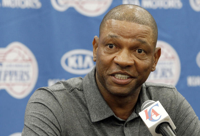 Former Boston Celtics head coach Doc Rivers talks at a press conference in Los Angeles on Wednesday, June 26, 2013. Rivers was introduced as the Los Angeles Clippers' new coach and senior vice president of basketball operations. (AP Photo/Nick Ut)