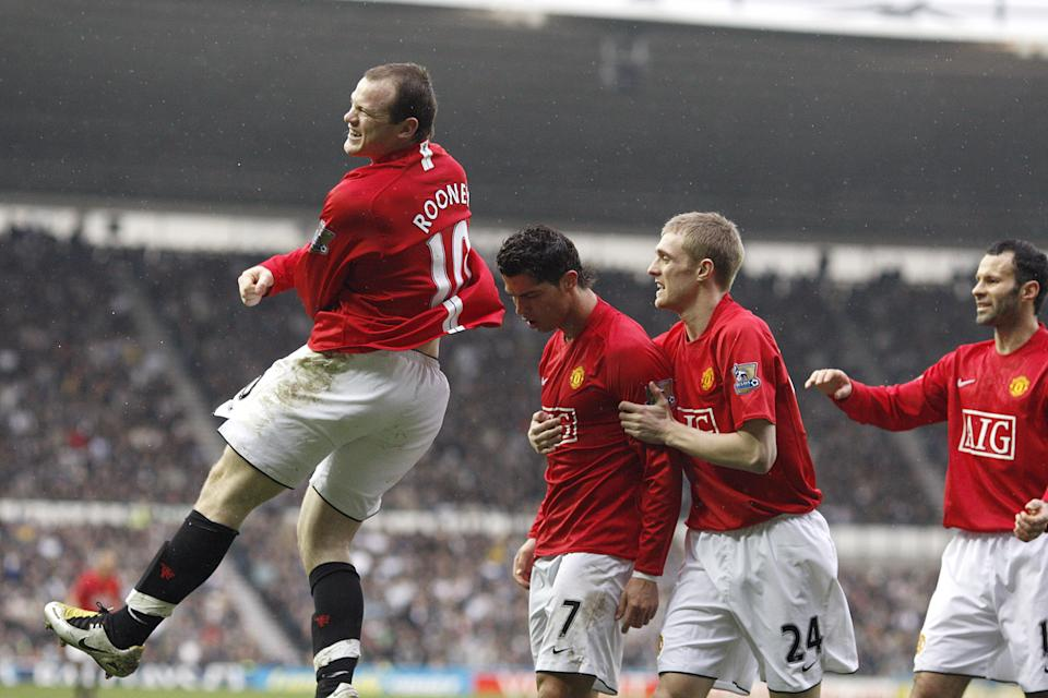 Manchester United's Wayne Rooney (l) and Darren Fletcher (2nd r) congratulate team mate Cristiano Ronaldo (c) on scoring the first goal (Photo by Dave Thompson - PA Images/PA Images via Getty Images)