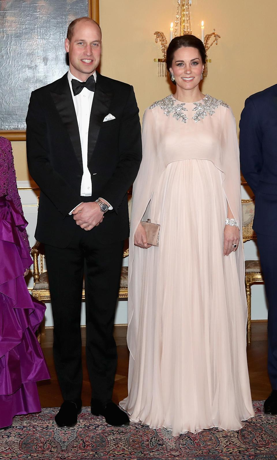 <p>For a dinner at the Royal Palace in Oslo, the Duchess of Cambridge wore a floor-skimming pink gown by Alexander McQueen (complete with a cape). <em>[Photo: Getty]</em> </p>