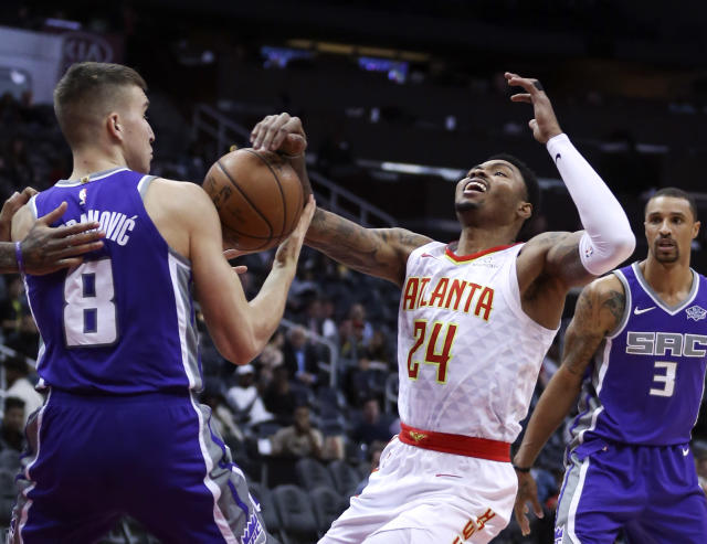Atlanta Hawks guard Kent Bazemore (24) looses the ball as he drives against Sacramento Kings guard Bogdan Bogdanovic (8) during the first half of an NBA basketball game Wednesday, Nov. 15, 2017, in Atlanta. (AP Photo/John Bazemore)