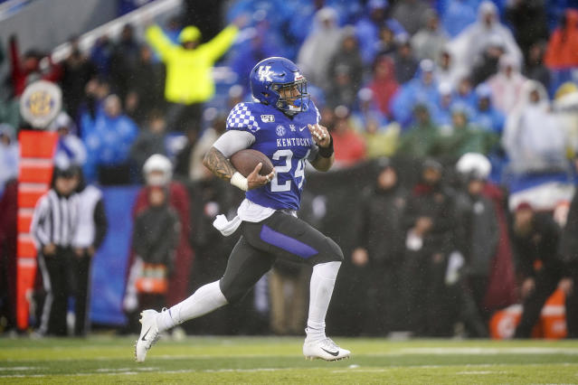 Kentucky running back Christopher Rodriguez Jr. (24) runs for a touchdown during the second half of the NCAA college football game against Louisville, Saturday, Nov. 30, 2019, in Lexington, Ky. (AP Photo/Bryan Woolston)