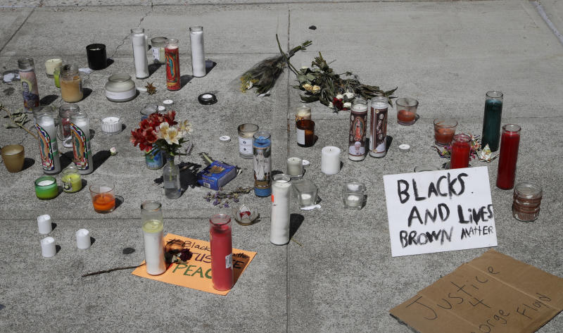 Candles and signs left at the entrance to closed Vallejo city hall seen on Wednesday, June 3, 2020, in Vallejo, Calif. (AP Photo/Ben Margot)
