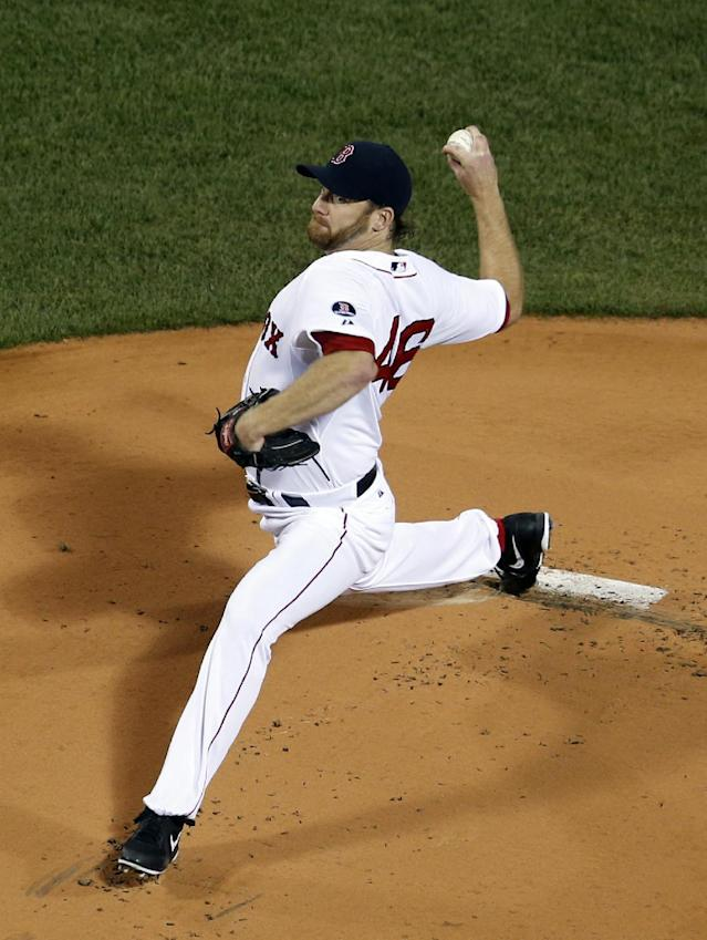 Boston Red Sox starting pitcher Ryan Dempster delivers to the Baltimore Orioles in the first inning of a baseball game at Fenway Park in Boston, Tuesday, Sept. 17, 2013. (AP Photo/Elise Amendola)