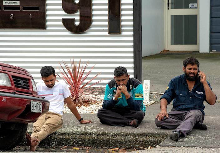 <p>Grieving members of the public sit on a curb following a shooting resulting in multiple fatalies and injuries at the Masjid Al Noor on Deans Avenue in Christchurch, New Zealand, 15 March 2019. (Photo by EPA/Martin Hunter NEW ZEALAND OUT) </p>