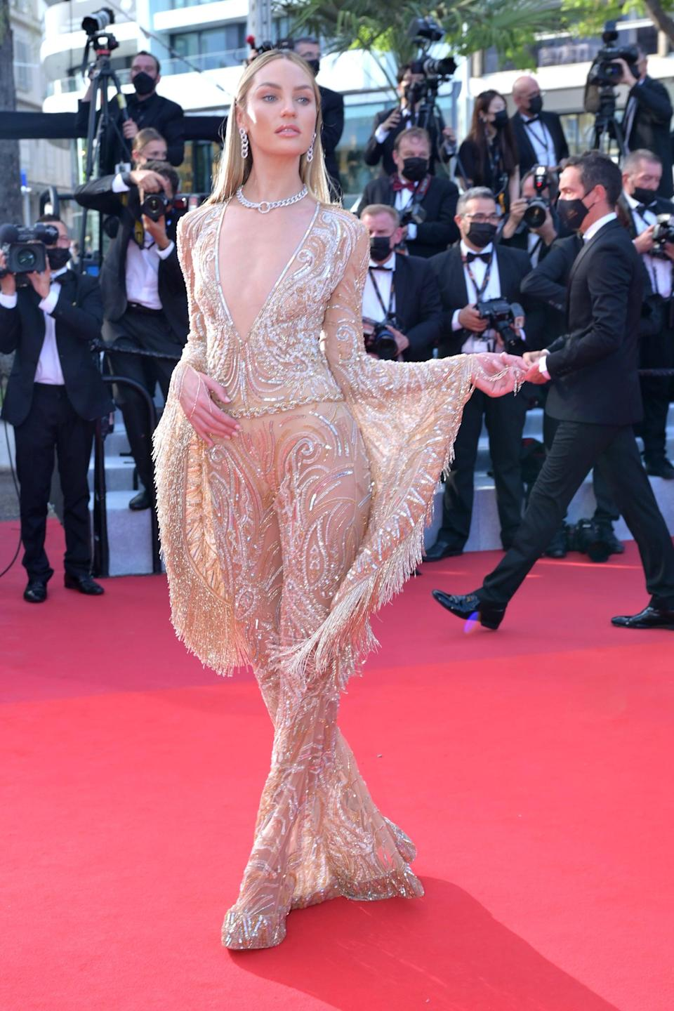 <p>Wearing a jumpsuit by Etro.</p>