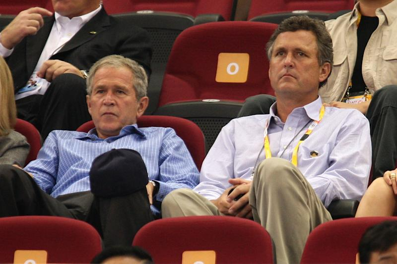 U.S. President George W. Bush and brother Marvin Bush watch a basketball game at the Summer Olympics on August 9, 2008 in Beijing, China. (Photo by Mark Dadswell/Getty Images) -- Son of George H.W. Bush & Barbara Bush -- Brother of George W. Bush, Jeb Bush, Pauline Robinson Bush, Neil Bush, Dorothy Bush Koch