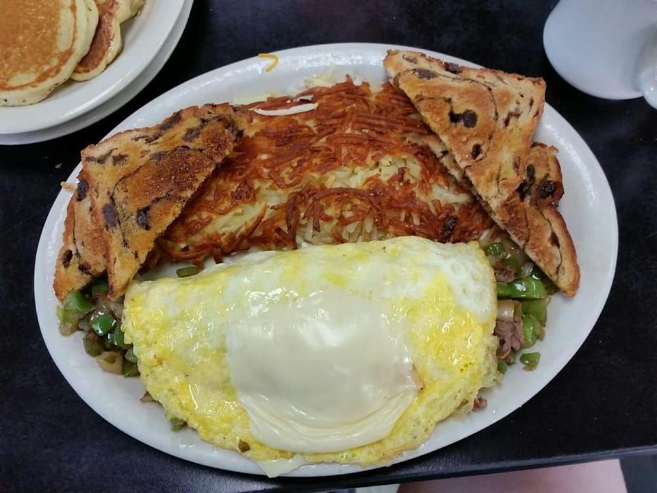 """<p><a href=""""https://www.yelp.com/biz/lucys-diner-rogers"""" rel=""""nofollow noopener"""" target=""""_blank"""" data-ylk=""""slk:Lucy's Diner"""" class=""""link rapid-noclick-resp"""">Lucy's Diner</a> in Rogers</p><p>Yelp reviews praise this little place for serving breakfast all day long. Once you've tried a heaping portion of their crispy hash browns, you'll know why.</p>"""