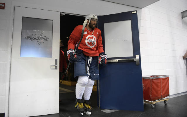 Washington Capitals left wing Alex Ovechkin, of Russia, exits the locker room for an NHL hockey practice, Saturday, May 26, 2018, in Arlington, Va. Ovechkin is having fun, scoring goals, leading the Capitals to the Stanley Cup Final and destroying the bad rep some laid on him for not being able to get past the second round of the playoffs. (AP Photo/Nick Wass)