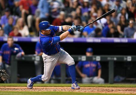 Jun 20, 2018; Denver, CO, USA; New York Mets second baseman Asdrubal Cabrera (13) hits a two run single in the fifth inning against the Colorado Rockies at Coors Field. Mandatory Credit: Ron Chenoy-USA TODAY Sports