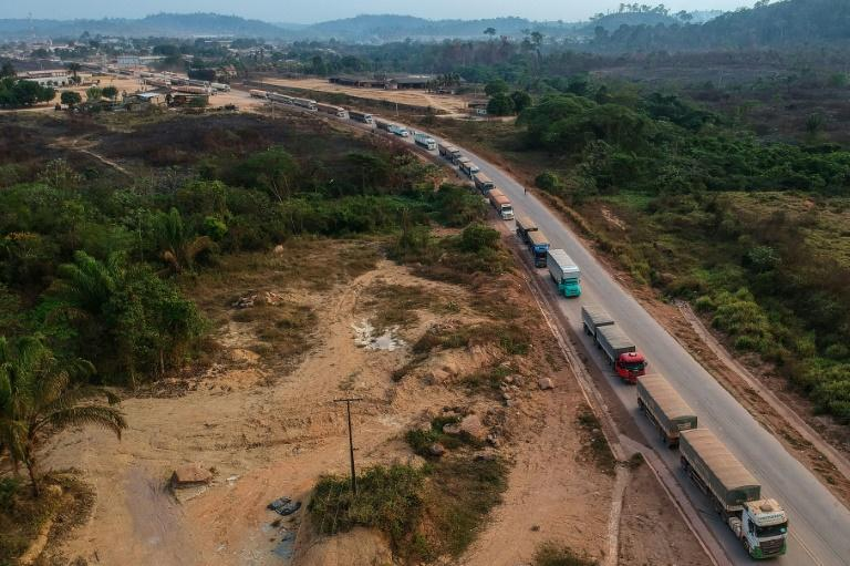 An aerial view of trucks queueing on the BR163 in Brazil's Para state -- one of two major transport routes that have played a key role in the development and destruction of the Amazon, the world's largest rainforest