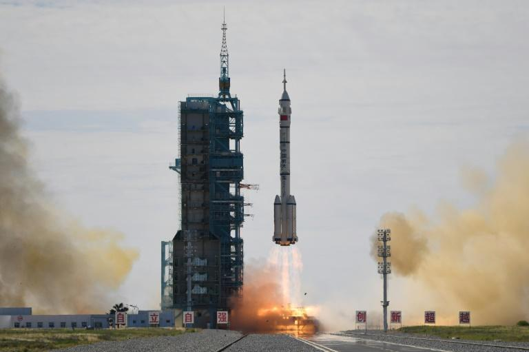 The Long March-2F carrier rocket carried a crew of three astronauts to China's new space station