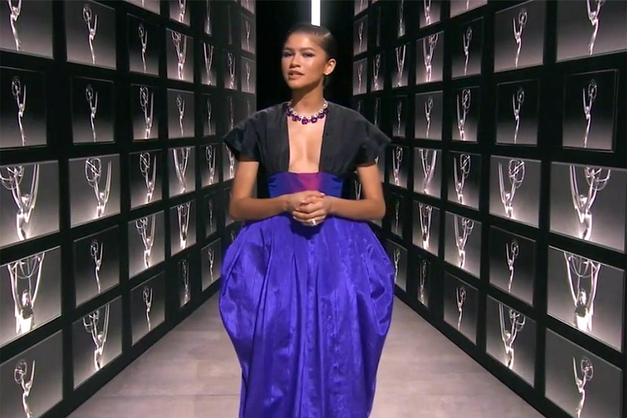 """<p>The<em>Euphoria</em> star promised <a href=""""https://people.com/style/zendaya-still-wants-to-pull-a-look-for-the-virtual-emmy-awards/"""">she would """"pull a look""""</a> for the virtual show, and boy, did she deliver. With the help of close friend and """"image architect""""<a title=""""(opens new window)"""" href=""""https://www.instagram.com/luxurylaw/?hl=en"""" target=""""_blank"""">Law Roach</a>, Zendaya created an unforgettable Emmys fashion moment: a plunging Christopher John Rogers dress with a royal purple taffeta skirt complete with a built-in cummerbund. She accessorized the look with a head-turning Bulgari necklace.</p>"""