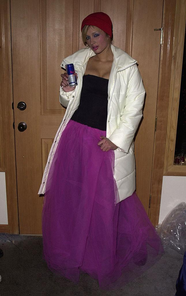 Paris Hilton displays a can of Red Bull while wearing a princess skirt and ski parka.